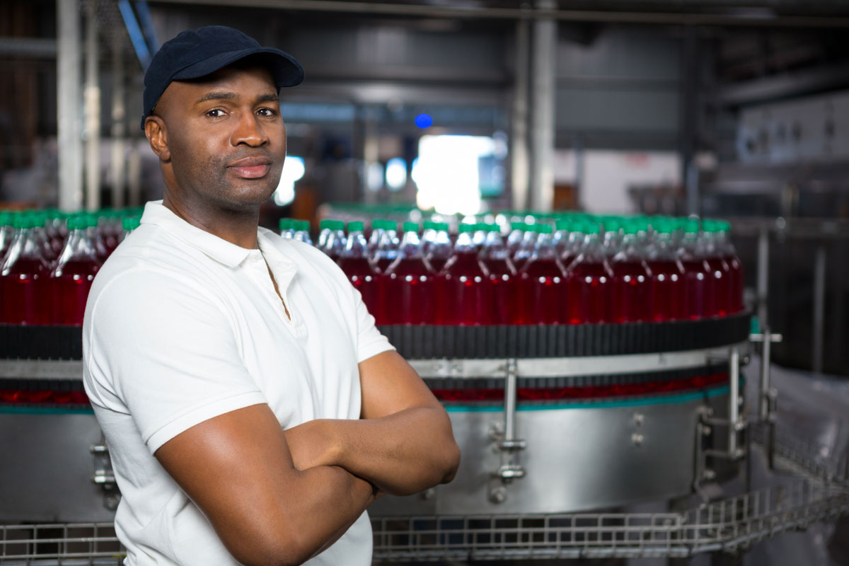 Male employee at a bottling factory