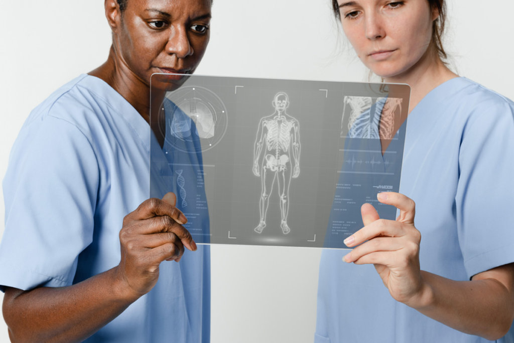 Two doctors holding and reviewing a x-ray chart.
